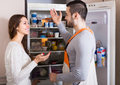 Woman showing broken refrigerator Royalty Free Stock Photo