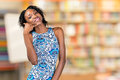 Woman showing call me sign smiling african american Royalty Free Stock Photo