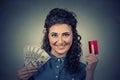 Woman showing credit card and cash dollar banknotes bills Royalty Free Stock Photo