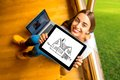 Woman showing digital tablet in the wooden house Royalty Free Stock Photo
