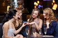 Woman showing engagement ring to her friends Royalty Free Stock Photo