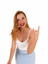 Woman showing the finger a lovely slim in a blue skirt and white top standing isolated for white background and giving Royalty Free Stock Photography