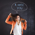 Woman showing hate next to a chalkboard with the words i you Royalty Free Stock Photo