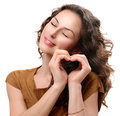 Woman showing heart in love with her hands st valentine s day Royalty Free Stock Photos