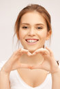 Woman showing heart shape Stock Images