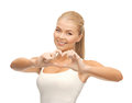 Woman showing heart shape gesture picture of Royalty Free Stock Image