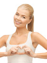 Woman showing heart shape gesture picture of Royalty Free Stock Photo