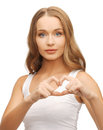 Woman showing heart shape health charity in white shirt with hands Royalty Free Stock Images