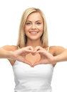 Woman showing heart shape picture of in white tank with hands Stock Photo