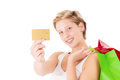 Woman showing her credit card blonde smiling golden on white background Stock Photo