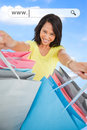 Woman showing her shopping bags under address bar on blue sky background Stock Photography