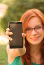 Woman showing her smart phone unrecognisable ginger Stock Photo