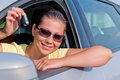 Woman showing the key of her new car Royalty Free Stock Image