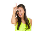 Woman showing loser sign closeup portrait funny laughing young displaying on forehead looking at you camera with disgust gesture Royalty Free Stock Image
