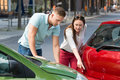Woman Showing Man Car Collision Royalty Free Stock Photo