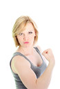 Woman showing off her biceps Stock Images