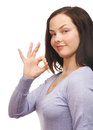Woman showing ok sign Stock Photo