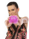 Woman showing pink  soft toy Royalty Free Stock Image