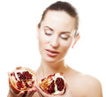 Woman showing pomegranate smiling. Stock Photo