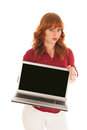 Woman showing screen laptop standing in studio and with copy space Stock Photos