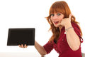 Woman showing tablet and ask to call us sitting on desk with copy space while asking Royalty Free Stock Photography