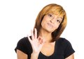 Woman showing three fingers sign Stock Photo
