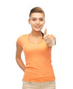 Woman showing thumbs up happy in blank color t shirt Stock Photo