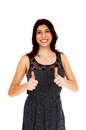 Woman showing thumbs up a lovely young in a dress standing with her isolated over white background Royalty Free Stock Images