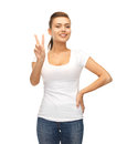 Woman showing victory or peace sign young smiling Stock Photos