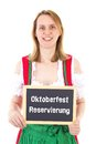 Woman shows blackboard oktoberfest reservation blond Royalty Free Stock Photos