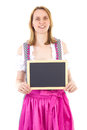 Woman shows blank chalkboard in dirndl Stock Image