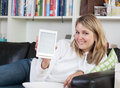 Woman shows an ebook reader Stock Photos