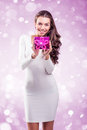 Woman Shows purple gift box for you Royalty Free Stock Photo