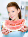 Woman shows a red water-melon Stock Photo