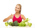 Woman shows thumbs up with organic food showing fruits and vegetables Stock Images