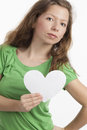 Woman shows white heart Stock Images