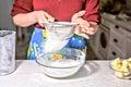 Woman sifting flour through sieve Royalty Free Stock Photo