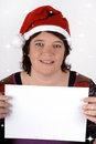 Woman with a sign wearing santa s hat and holding copy space Royalty Free Stock Photos