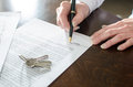 Woman signing a real estate contract on desk Stock Image