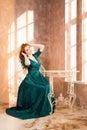 Woman siiting near window vintage interior luxury Stock Photos
