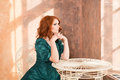 Woman siiting near window vintage interior luxury Royalty Free Stock Photography