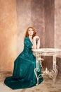 Woman siiting near window vintage interior luxury Stock Photography