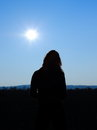 Woman silhouette of looking on the sun Royalty Free Stock Photos