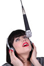 Woman singing into a microphone Royalty Free Stock Photography