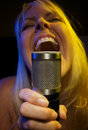 Woman Sings with Passion Stock Images