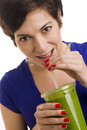 Woman sips Green Smoothie Royalty Free Stock Photo