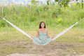 Woman sit on hammock in the park Royalty Free Stock Photography