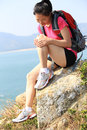 Woman sit on mountain rocks hiking seaside Royalty Free Stock Images
