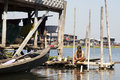 A woman sits on a small bamboo dock as she bathes in inle lake myanmar Stock Images