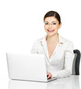 Woman sits from the table with laptop in white shirt beautiful smiling thу isolated on Stock Photos